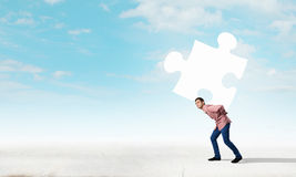 Man carry puzzle Royalty Free Stock Photo