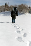Man carry a sledge in the deep snow, footprints in the front Stock Photo