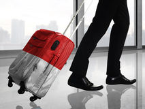 Man carry suitcase with indonesian flag texture Stock Photo