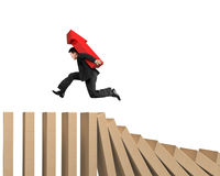 Man carrying arrow up running on falling wooden dominos. Man carrying red arrow up sign running on falling wooden dominos, isolated on white background Stock Photos