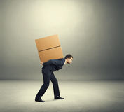 Man carrying on the back Royalty Free Stock Images