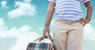 Man carrying a bag against sky in background Stock Images