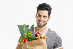 Man carrying a bag full of vegetables Royalty Free Stock Images