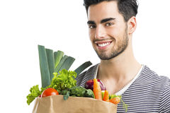 Man carrying a bag full of vegetables Royalty Free Stock Image