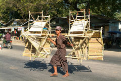Man carrying bamboo chairs and tables on the street of Thazi Royalty Free Stock Photo