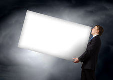 Man carrying banner Stock Photo