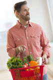 Man Carrying Basket Full Of Vegetables Stock Photography