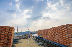 Man carrying a basket of rice husk, brick kiln factory Royalty Free Stock Image