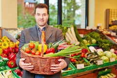 Man carrying basket with vegetables Stock Photos