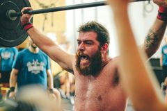 Man Carrying Black Barbell Royalty Free Stock Photos