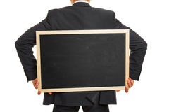 Man carrying blackboard on back Stock Photo