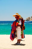 Man Carrying Blankets in Cabo San Lucas, Mexico Royalty Free Stock Images