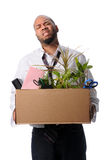 Man Carrying Box With Belongings. After loosing job Royalty Free Stock Photo