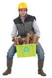 Man carrying recyclable wood Stock Photos
