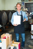 Man carrying box in wine house Royalty Free Stock Image