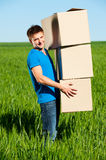 Man carrying boxes Royalty Free Stock Photos