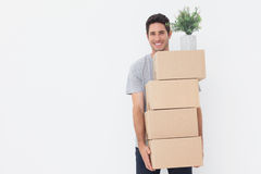 Man carrying boxes because he is moving in a new house Stock Photo