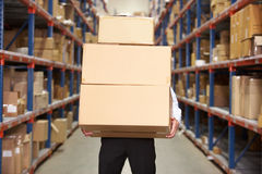 Man Carrying Boxes In Warehouse stock photo