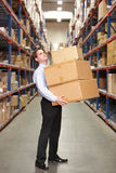 Man Carrying Boxes In Warehouse Stock Images