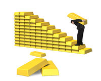 Man carrying bullion on golden stairs Stock Photography
