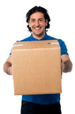 Man carrying cardboard box Royalty Free Stock Images