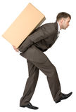 Man carrying cardboard box on his back Stock Photography