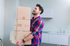 Man carrying cardboard boxes Royalty Free Stock Photo
