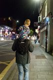 Man Carrying Child on Shoulders Stock Photography