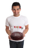 Man carrying chocolate cake decorated with hearts
