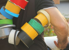 Man carrying colored masking tape. A man who is carrying colored masking tape Royalty Free Stock Images