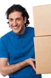Man carrying couple of cardboard boxes Stock Image