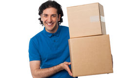 Man carrying couple of cardboard boxes Royalty Free Stock Image