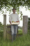 Man Carrying Crate Of Fruit And Vegetables Outdoors Stock Images