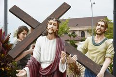Christian and the cross. A man carrying a cross royalty free stock photography