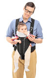 Man carrying a cute baby girl Stock Photos