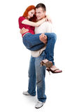 Man carrying cute girlfriend in his arms Stock Images