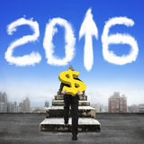 Man carrying dollar sign climbing old stairs toward 2016 clouds Stock Images
