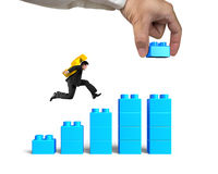 Man carrying dollar sign running bar graph block hand building Royalty Free Stock Images