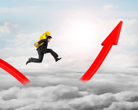 Man carrying dollar sign running on growing red arrow graph Stock Photography