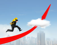 Man carrying dollar sign running on red arrow up graph Royalty Free Stock Images