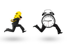 Man carrying Euro sign running after alarm clock Royalty Free Stock Photography