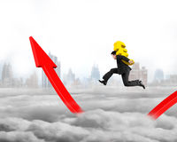 Man carrying Euro sign running on growing red arrow graph Royalty Free Stock Photo