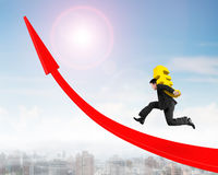 Man carrying Euro sign running on red arrow up graph Stock Image