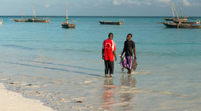 Man carrying fish on the African seashore Stock Photography