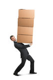 Man carrying four heavy boxes Stock Photos