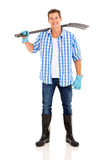 Man carrying garden fork Stock Image