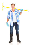 Man carrying garden rake Royalty Free Stock Image