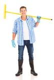 Man carrying garden rake Royalty Free Stock Image