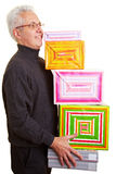 Man carrying gifts Stock Images