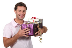 Man carrying gifts Stock Image